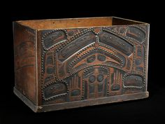Haida Object name:Box Date created:circa 1860 Place:Queen Charlotte Islands (Haida Gwaii); Skeena-Queen Charlotte Regional District; British Columbia; Canada Media/Materials:Yellow cedar, brass tacks/bosses, paint Techniques:Carved, painted, studded Collected by Captain D.F. Tozier (1843-1926, associated with the U.S. Revenue Cutter Service) between 1894 and 1907; purchased by MAI in 1917. 86 x 53 x 54.5 cm Catalog n 7/1118 National Museum of the American Indian