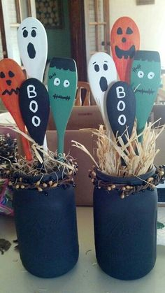 Kids holloween decorstions using wooden spoon paint and jar