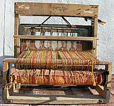 Antique Hand Loom, Weaving the Old Way.  Jaquard Coverlets were Woven on this Type Loom.  You Were Lucky in This Early Era if you Owned One.