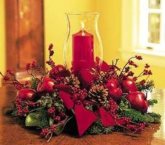 What better way to light up wintry hearts than with a gorgeous candle set in a hurricane globe? A decorator's delight. Douglas fir, oregonia, pinecones, apples and berries decorate a red pillar candle inside of a 12 hurricane globe. Christmas Flower Arrangements, Christmas Flowers, Christmas Candles, Christmas Wreaths, Christmas Decorations, Christmas Tree, Holiday Decor, Family Holiday, Elegant Christmas