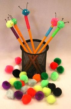 Make pencil toppers! All you need is colored tape,colored cotton balls, small google eyes, and black paper!