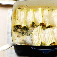 "Spinach Chicken Manicotti Recipe -Pepper and nutmeg spice up the rich sauce in this hearty pasta dish from Amy Luce of Mansfield, Texas. ""I made this for my husband on our first Valentine's Day when we were dating,"" she says. ""It was a big success. Chicken Manicotti, Manicotti Recipe, Spinach Manicotti, Cheese Manicotti, Cheese Ravioli, Pasta Recipes, Dinner Recipes, Cooking Recipes, Dinner Ideas"