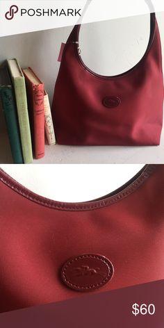 c2d51491cae76 Longchamp Shoulder Bag Great condition and great shape! Longchamp red  shoulder bag with zipper.