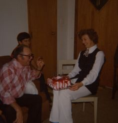 My mother loved to have a party and to entertain.  Here she presents a New Year's birthday cake to my uncle.