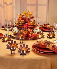 """The Set of 6 Turkey Tea Light Candleholders is a delightful touch to your tablescape. Use these rustic turkeys to hold your own real or LED tea light candles. You get 3 sitting and 3 standing turkeys. Approx. 4""""W x 2-3/4""""D x 4""""H, each. Metal."""