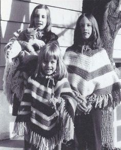 Ponchos!  I had one just like the one on the right, in navy and red.