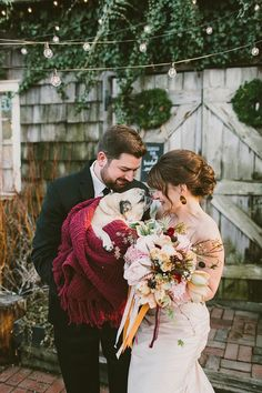 Puppy Wrapped in a blanket for a winter wedding