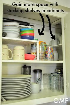 Gain more space with stacking shelves in cabinets. 31 Days of Spontaneous Organizing - Day #25: Kitchen Cupboards