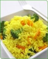 Lemon Rice with Seasonal Vegetables - 1 cup uncooked brown rice - long-grain, 1 tsp ground turmeric or lemon pepper, 2 1/4 cup(s) uncooked broccoli florets, 1 medium uncooked carrot sliced, 1 medium lemon - juice and zest, 1/3 tsp black pepper, 1/8 tsp salt, sliced almonds optional