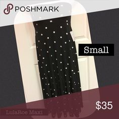 Small Maxi Lularoe Skirt or wear as a dress! NWT Small Maxi Lularoe Skirt or wear as a dress NWT . Very comfortable! Fits size 6-8 Black with white polka dots! Fun pattern! LuLaRoe Skirts Maxi