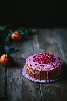 Olive Oil Tangerine Cake with Pomegranate Glaze | Adventures in Cooking So this has to be one of the top three cakes I have ever made. This Olive Oil Tangerine Cake with Pomegranate Glaze is drool worthy. #oliveoil #oliveoilcake #oilcake #cake #tangerine #pomegranate #glaze #dessert #winter #holidays #adventuresincooking