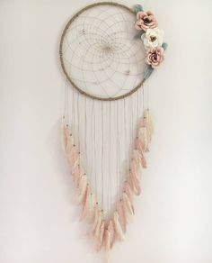 A personal favorite from my Etsy shop https://www.etsy.com/ca/listing/551636193/20-floral-dream-catcher