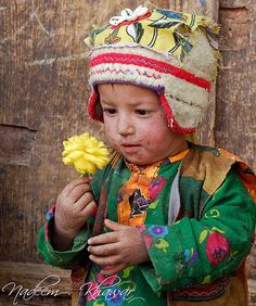 Yellow Flower    Ashkole, Called the last village of world.  A kid of Ashkole, Pakistan playing in street.