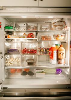 fridge organization for a family with spots for everything and drawers and plastic dividers / fridge that is organized and functional