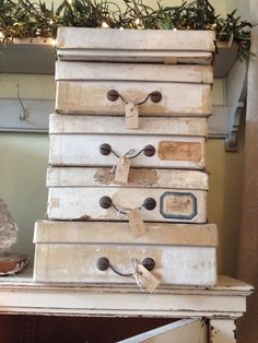 I think I might have to have a go at doing something like this with my old (way too patterned) boxes, it's so cute!