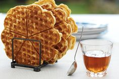 Is there anything more delicious for a weekend brunch or supper than homemade waffles, fresh from the waffle iron, crispish on the outside and tender in the middle? My nan was the master of the waffle iron, and this recipe is hers. Waffle batter is best made several hours ahead, or better still, the night before, with beaten egg whites added just before cooking. They'll be eaten faster than you can make them, so aim to have a few ready before everyone arrives at the table. If you don'...