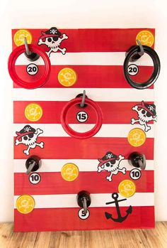 Great idea for a pirate party - this pirate hook toss game is really easy to make and all you need is a large piece of cardboard, some paper plates with the middle cut out and a few pirate hooks! And other pirate games - party delights Pirate Party Games, Party Games Group, Diy Party Games, Birthday Party Games, Craft Party, Ideas Party, Game Ideas, Pirate Games For Kids, Diy Games