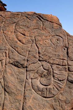 Digital photograph; detail of engraved rock art on a rock boulder, showing the outlined figure of an elephant. Wadi BeddisMessak Settafet, Libya