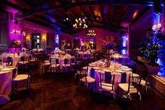 Elegant reception tables and purple uplighting