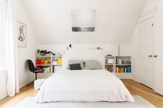 built in closet, white bedding, rainbow bookshelf // San Francisco Home   A Cup of Jo