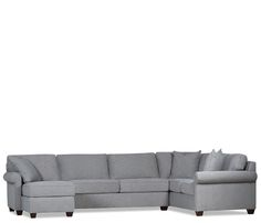 Transitional styling and superb construction, the Marshall is stocked in a durable gray fabric with coil seat cushions, feather toss pillows, and dark finish wooden legs.