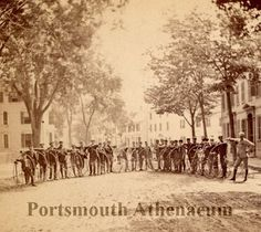 Portsmouth Wheelmen 1883 on Pleasant St btw State and Court