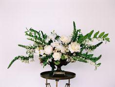 Elegant florals in brass vessels
