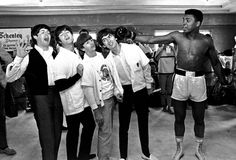 Miami: Feb. 18, 1964 Paul McCartney, John Lennon, Ringo Starr and George Harrison take a fake blow from Cassius Clay. IMAGE: AP PHOTO