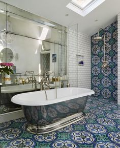 This colourful ensuite in a south-west London Victorian terrace has mixed classic Drummonds fittings with vibrant Mediterranean style tiles and glamorous accessories and finishes, featured in Homes & Gardens October 2015 Dream Bathrooms supplement. Drummonds' products used include the Double Crake vanity unit, the Tay bath, the Dalby shower, Brora WC plus various taps and accessories drummonds-uk.com