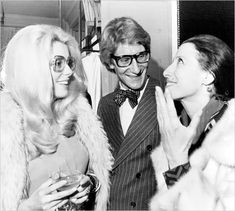 Catherine Deneuve, left, and the Russian ballerina Maia Plisetskaia after he presented his collection in Paris in 1973. Mr. Saint Laurent often sought inspiration on the streets, bringing the Parisian beatnik style to couture runways. Photo: Jean Jacques Levy/Associated Press