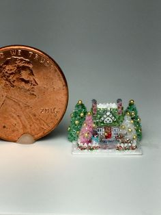 OOAK Miniature Dollhouse Christmas Putz =Lovely little cape cod cottage house with snowman and Rudolph reindeer in the front yard. -Green, pink and white chenille Christmas trees and pretty picket fence with painted holly garland. -Scene is glittered with fine crystal glass glitter.  Z