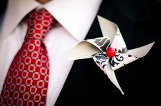 A whimsical pinwheel boutonniere for the groom. #MarthaStewartWeddingsMagazine
