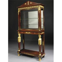 AN EMPIRE STYLE GILT-BRONZE AND CARVED GILTWOOD MOUNTED MAHOGANY VITRINE ON STAND<br>PARIS, CIRCA 1890 | lot | Sotheby's