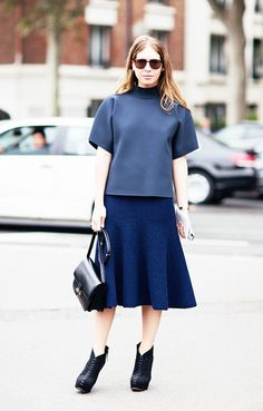 Punch up an all-neutral outfit with sleek silhouettes, like a mockneck top and full skirt. // #StreetStyle