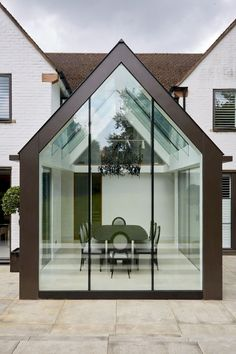 Contemporary mono pitched structurally glazed roof dining room with bronze cladding, laminated glass beams and frameless glass gable wall Extension Veranda, House Extension Design, Extension Designs, Orangery Extension, Glass Extension, Extension Ideas, Garden Room Extensions, House Extensions, Bungalow Extensions