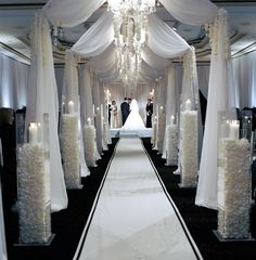 I think this will be a great idea for the ceremony. I like the draping with the chandeliers. I like the height of the candle décor, but maybe we can do something a little different