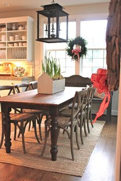 Farmhouse table with chairs and pew along wall for extra seating when needed.