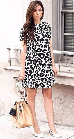 You can never go wrong with a printed dress and classic pumps.