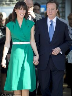 Winning in the style stakes: Samantha Cameron, wearing an £185 Hampton dress in emerald gr...