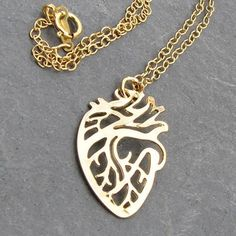 Gold plated anatomical heart pendant. Silver version also available. Classy, great gift.