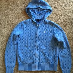 Ralph Lauren hooded zip-up blue cardigan w/pockets Gently worn, hooded Ralph Lauren Sport blue cardigan with yellow polo symbol. Metal zipper. Says large on tags, but fits S-M. Slight fading because it has been well-loved, but no other defects. Ralph Lauren Sweaters Cardigans