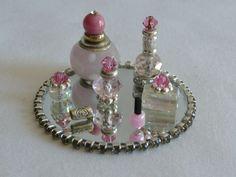 Dollhouse Miniature Perfume Bottle Vanity Set, 8 piece by CherylsWeeWonders on Etsy https://www.etsy.com/listing/211267919/dollhouse-miniature-perfume-bottle: