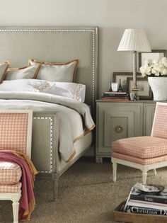 Love the shades of taupe with the peach and white....not so much the rose throw. Headboard and lamp are very good.