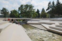 enota's reorganized pedestrian zone in slovenia includes a riverside amphitheater