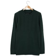 Roamers & Seekers Raven Alpine Green Jumper: Roamers & Seekers take on a classic green fisherman style knit. Raven has a roll edge neck with a 1950s inspired multi cable upper body. A contemporary twist on a classic cable knit. Roomy enough to layer over a classic shirt.  Fisherman's wide neckline with roll edge Multi cable design at top of body Fold over rib cuff Roamers and Seekers felt badge on the back neck