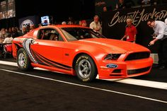 2014 Ford Mustang Cobra Jet prototype sold for $200,000 at Barrett-Jackson. Ford Motor Company auctioned it at no reserve, proceeds will benefit the National Multiple Sclerosis Society.