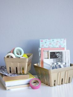 Spray paint some recycled berry baskets for easy storage. | 54 Ways To Make Your Cubicle Suck Less