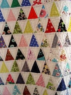 "Pyramid Quilt - 60 degree triangle quilt - tutorial here!  If you do 8 triangles a day this spring you'll get a quilt that's 56"" wide and 62"" long!"