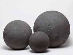 The Molly Cement Spheres by Made Goods set a sensational stage—the three sizes of our mammoth Molly balls can sculpturally shape a large space. Group them in an entry hall, or outside on a patio or in a courtyard.