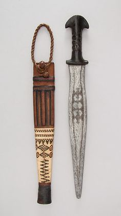 Sword with Scabbard Date: late 19th century Culture: West African, possibly Tuareg Medium: Iron, leather Dimensions: L. with sheath 20 5/8 in. (52.4 cm); L. without sheath 19 13/16 in. (50.3 cm); W. 2 9/16 in. (6.5 cm); Wt. 11.8 oz. (334.5 g); Wt. of sheath 3.9 oz. (110.6 g) Classification: Swords